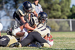 Palos Verdes, CA 09/27/13 - Steven Smith (Peninsula #3), Carlo Merola (Peninsula #60) and Alex Rosemond (Peninsula #11) and unidentified Lawndale player(s) in action during the Lawndale vs Palos Verdes Peninsula Varsity football game at Peninsula High School.