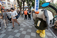 Touchi, a mascot for the Tokyo area Japanese Self Defence Force (JSDF) greats pedestrians, who mostly ignore him, in Ikebukuro, Tokyo, Japan Friday September 29th 2017. The Ministry of Defence, each Autumn starts a recruitment drive to encourage more young people to join the Japanese Self Defence Force. Military service in Japan is neither compulsory nor popular and with regional tensions increasing and Hawkish politicians in power they are gain to raise the number of military personnel available.
