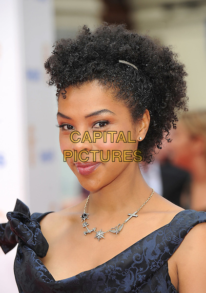 SOPHIE OKONEDO .at the Philips British Academy Television Awards (BAFTA) at the London Palladium, London, England,.June 6th, 2010..BAFTAs TV  arrivals portrait headshot black blue navy bows silver charms necklace .CAP/BEL.©Tom Belcher/Capital Pictures.