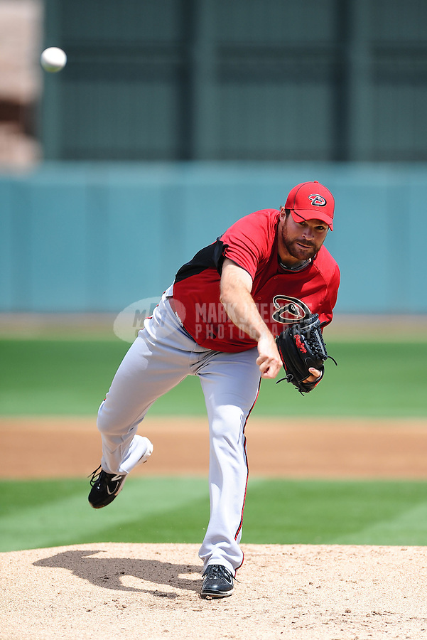 Mar. 19, 2012; Phoenix, AZ, USA; Arizona Diamondbacks pitcher Josh Collmenter throws in the first inning against the Oakland Athletics during a spring training game at Phoenix Municipal Stadium.  Mandatory Credit: Mark J. Rebilas-