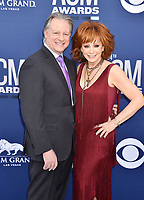 LAS VEGAS, CA - APRIL 07: Anthony &ldquo;Skeeter&rdquo; Lasuzzo (L) and Reba McEntire attend the 54th Academy Of Country Music Awards at MGM Grand Hotel &amp; Casino on April 07, 2019 in Las Vegas, Nevada.<br /> CAP/ROT/TM<br /> &copy;TM/ROT/Capital Pictures