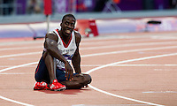 05 AUG 2012 - LONDON, GBR - Dwain Chambers (GBR) of Great Britain recovers after his men's 100m semi final during the London 2012 Olympic Games athletics in the Olympic Stadium at the Olympic Park in Stratford, London, Great Britain. Chambers failed to qualify for the final (PHOTO (C) 2012 NIGEL FARROW)
