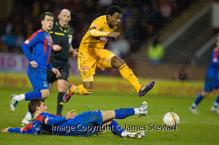 MOTHERWELL'S OMAR DALEY RIDES THE CHALLENGE FROM CALEY'S THOMAS PIERMAYR..14/01/2012 sct_jsp009_motherwell_v_ict     .Copyright  Pic : James Stewart.James Stewart Photography 19 Carronlea Drive, Falkirk. FK2 8DN      Vat Reg No. 607 6932 25.Telephone      : +44 (0)1324 570291 .Mobile              : +44 (0)7721 416997.E-mail  :  jim@jspa.co.uk.If you require further information then contact Jim Stewart on any of the numbers above.........
