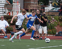 In a National Women's Soccer League Elite (NWSL) match, Portland Thorns FC defeated the Boston Breakers, 2-1, at Dilboy Stadium on July 21, 2013.  Portland Thorns FC defender Rachel Buehler (16) and Boston Breakers midfielder Heather O'Reilly (9) battle for the ball near the Thorns' goal line.
