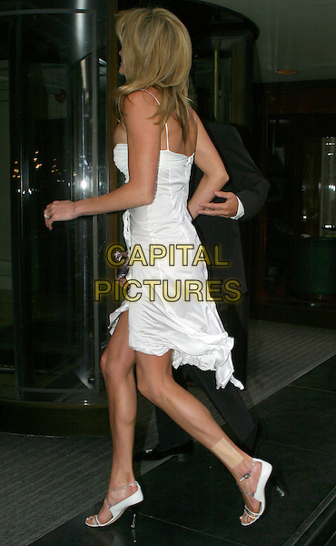 PENNY LANCASTER.Sony Radio Academy Awards.full length, full-length, white dress, plaster, bandage, band aid, wound, hurt, back, behind, rear.www.capitalpictures.com.sales@capitalpictures.com.© Capital Pictures.