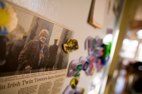 An article on the fridge about a memorial to her brother in the Irish town where her family is from. Rosaleen's group is asking why other countries have provided 9/11 memorials that please all family members while NY  is struggling to even start on their's..A day in the life of Rosaleen Tallon, sister of firefighter Sean Tallon killed in the 9/11 World Trade Center attacks. In response to the proposed WTC memorial being built underground at the site, Ms. Tallon has been sleeping for 16 days in front of the fire house across from the WTC site. She and several other WTC families are protesting the memorial design and asking for the victim's names to be placed above ground for the sake of honoring the lives lost and safety concerns with any possible future evacuation of the site.