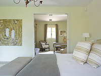 A comfortable dressing room is situated to one side of the master bedroom