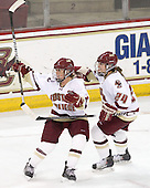 Caitlin Walsh (BC - 11) and Meagan Mangene (BC - 24) celebrate Walsh's goal. - The Boston College Eagles defeated the Harvard University Crimson 3-1 to win the 2011 Beanpot championship on Tuesday, February 15, 2011, at Conte Forum in Chestnut Hill, Massachusetts.