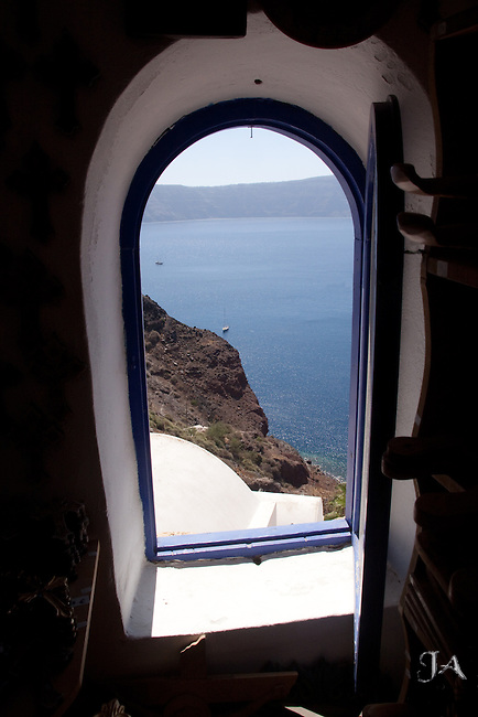 View of the Aegean thru a window in Oia, Santorini