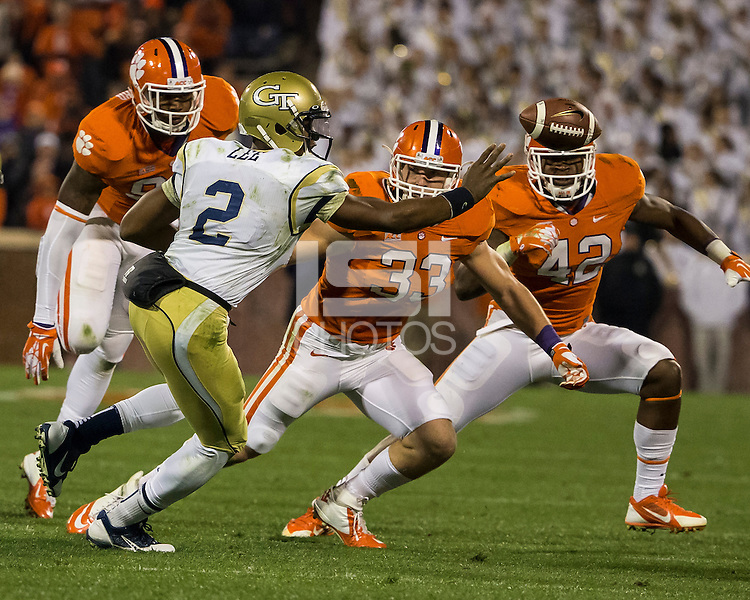 The eighth ranked Clemson Tigers defeat the Georgia Tech Yellow Jackets at Death Valley 55-31 in an ACC matchup.  Georgia Tech Yellow Jackets quarterback Vad Lee (2), Clemson Tigers linebacker Spencer Shuey (33), Clemson Tigers linebacker Stephone Anthony (42)