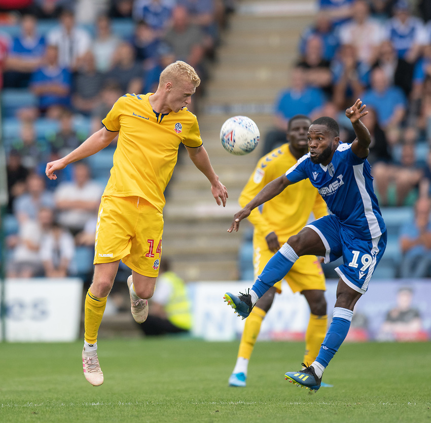 Bolton Wanderers' James Weir (left) battles with Gillingham's Mark Marshall (right) <br /> <br /> Photographer David Horton/CameraSport<br /> <br /> The EFL Sky Bet League One - Gillingham v Bolton Wanderers - Saturday 31st August 2019 - Priestfield Stadium - Gillingham<br /> <br /> World Copyright © 2019 CameraSport. All rights reserved. 43 Linden Ave. Countesthorpe. Leicester. England. LE8 5PG - Tel: +44 (0) 116 277 4147 - admin@camerasport.com - www.camerasport.com