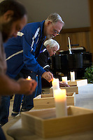 BURLINGTON, WA - SEPTEMBER 24: People light candles during a vigil held at the Central United Methodist Church on September 24, 2016 in Sedro-Woolley, Washington. The vigil was held for the community in response to the shooting deaths of five people in the Cascade Mall last night. (Photo by Karen Ducey/Getty Images)