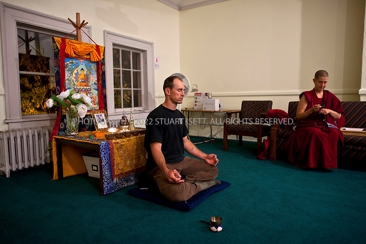 9/21/2011--Seattle, WA, USA..Climber Chad Kellogg, 39, at a Buddhist meditation class at All Pilgrim's Church in Seattle's Capitol Hill neighborhood. The son of presbyterian missionaries, Kellogg is now a practicing Buddhist...©2011 Stuart Isett. All rights reserved.
