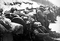 Astonished Marines of the 5th and 7th Regiments, who hurled back a surprise onslaught by three Chinese communist divisions, hear that they are to withdraw! Ca.  December 1950.  Sgt. Frank C. Kerr. (Marine Corps)<br /> Exact Date Shot Unknown<br /> NARA FILE #:  127-N-A4852<br /> WAR &amp; CONFLICT BOOK #:  1392