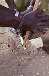 Turkana men  starting a  fire  by using  friction sticks.- Lokitaung...Northern Kenya.....