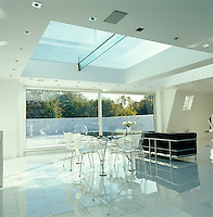 General view of the living/dining area of the penthouse towards the roof terrace