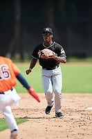 GCL Marlins shortstop Osiris Johnson (9) waits to receive a throw as Freudis Nova (16) is caught in a rundown during a game against the GCL Astros on August 5, 2018 at FITTEAM Ballpark of the Palm Beaches in West Palm Beach, Florida.  GCL Astros defeated GCL Marlins 2-1.  (Mike Janes/Four Seam Images)