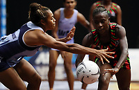 24.02.2018 Malawi's Takondwa Lwazi and Fiji's Alanieta Waqainabete in action during the Malawi v Fiji Taini Jamison Trophy netball match at the North Shore Events Centre in Auckland. Mandatory Photo Credit ©Michael Bradley.