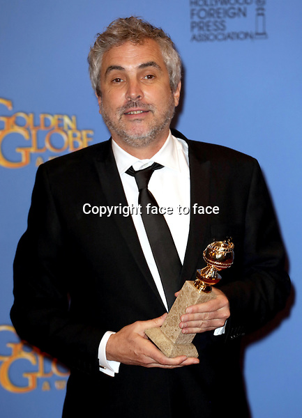 Los Angeles, California - January 12: Alfonso Cuaron attending the 2014 Golden Globe Awards - Press Room in Los Angeles, California on January 12, 2014. . <br />