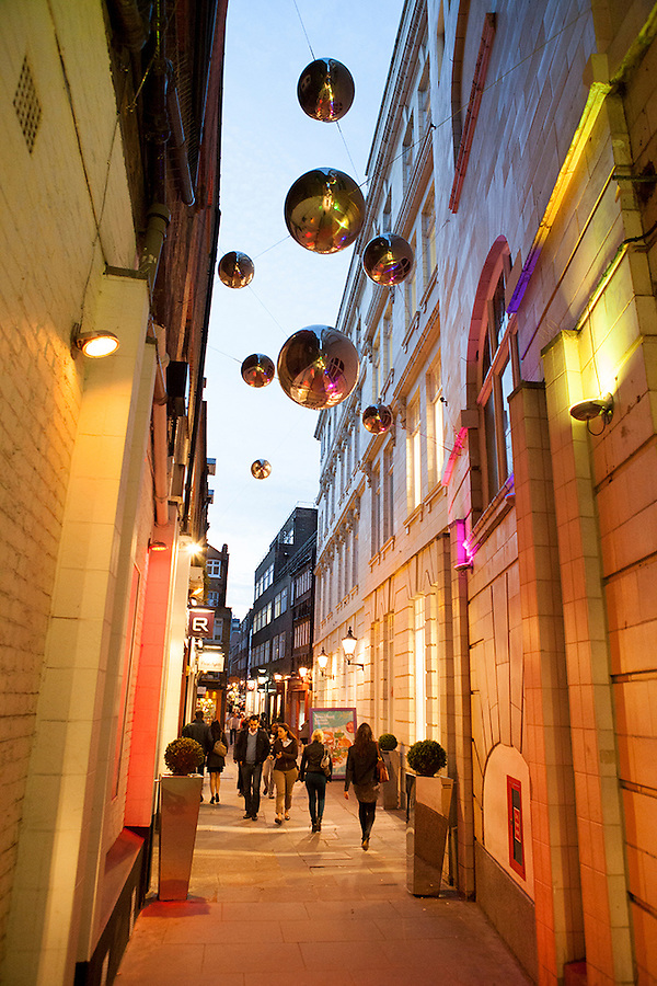 Shoppers along St Christopher's Place at dusk, London, England, UK, Europe