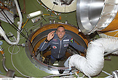 South African space flight participant Mark Shuttleworth enters the functional cargo block's (FGB) pressurized adapter on the International Space Station (ISS). Shuttleworth and his Soyuz Taxi crewmates, Commander Yuri Gidzenko and Flight Engineer Roberto Vittori of the European Space Agency (ESA), arrived at the orbital outpost on April 27, 2002 at 2:56 a.m. (CDT) as the two vehicles flew over Central Asia. <br /> Credit: NASA via CNP