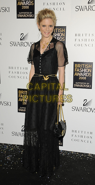EMILIA FOX.Inside arrivals at the British Fashion Awards 2008 held at The Lawrence Hall in London, England. UK, .November 25th 2008.full length black long dress sheer lace gold belt buckle bag purse bracelet.CAP/CAN.©Can Nguyen/Capital Pictures.