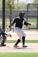 Jared Mitchell #22 of the Chicago White Sox hits a homerun in a minor league spring training game against the Cleveland Indians at the White Sox complex on March 24, 2011 in Glendale, Arizona. .Photo by:  Bill Mitchell/Four Seam Images.