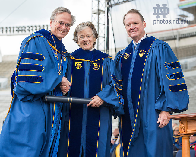 May 15, 2016; University of Notre Dame president Rev. John Jenkins, C.S.C., left, and Notre Dame Board of Trustees chairman Richard Notebaert,  present an honorary doctor of science degree to Rita Colwell, a Distinguished University Professor at both the University of Maryland and at Johns Hopkins University Bloomberg School of Public Health, during the 2016 Commencement ceremony at Notre Dame Stadium. (Photo by Barbara Johnston/University of Notre Dame)