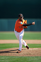 Baltimore Orioles relief pitcher Mychal Givens (60) delivers a pitch during a Spring Training game against the Minnesota Twins on March 7, 2016 at Ed Smith Stadium in Sarasota, Florida.  Minnesota defeated Baltimore 3-0.  (Mike Janes/Four Seam Images)