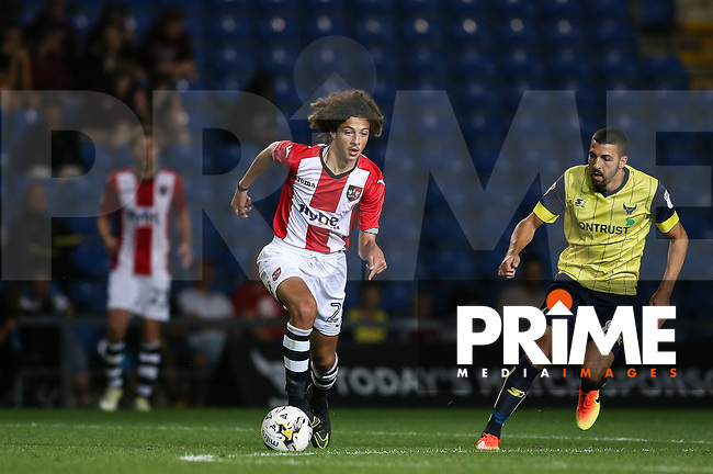 Ethan Ampadu of Exeter City heads away from Liam Sercombe of Oxford United during the The Checkatrade Trophy match between Oxford United and Exeter City at the Kassam Stadium, Oxford, England on 30 August 2016. Photo by Andy Rowland / PRiME Media Images.