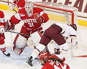 Erin O'Neil (BU - 31), Megan Keller (BC - 4) -  The Boston College Eagles defeated the visiting Boston University Terriers 5-0 on BC's senior night on Thursday, February 19, 2015, at Kelley Rink in Conte Forum in Chestnut Hill, Massachusetts.