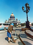 Woman sweeping street. Series of images of Leniningrad/St Petersburg Russia 1976