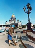 Woman sweeping street. Series of images of Leniningrad/St Petersburg Russia 1976