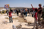 Palestinian, left-wing Israeli and foreign peace activists take part in the opening of the Susiya Creative and Learning Center in the mountains in the area of Yatta village close to the Jewish settlement of Sosia south of the West Bank city of Hebron, May 28, 2011. Photo by Najeh Hahlamoun.