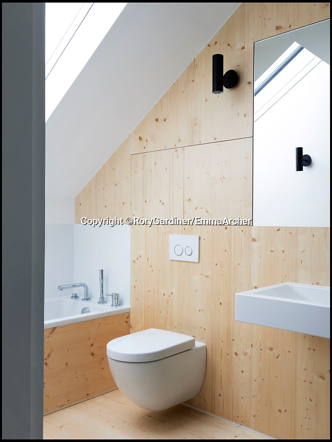 BNPS.co.uk (01202 558833)Pic: RoryGardiner/EmmaArcher/BNPS<br /> <br /> En-suite...<br /> <br /> Council Depot transformed into a million pound minimalist masterpiece.<br /> <br /> An architect has transformed a former council depot in Hackney into a stunning £1.35million property.<br /> <br /> James Davies, 34, has spent two years transforming the historic, dilapidated former school building in Stoke Newington, north east London, into a modern, stylish two-storey, two-bedroom house, living on site during the conversion. <br /> <br /> The renovation of the site at Defoe Road, which is yards from the high street, cost a hefty £350,000.<br /> <br /> But the investment has paid off handsomely as the property, which has its own inner courtyard, has already been snapped up for £1.35m.