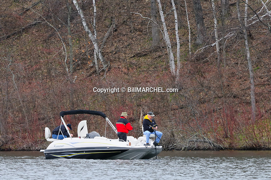 00416-028.02 Fishing: A leafless shoreline was testament to a late spring as three opening day anglers tried their luck on Gull Lake near Nisswa.