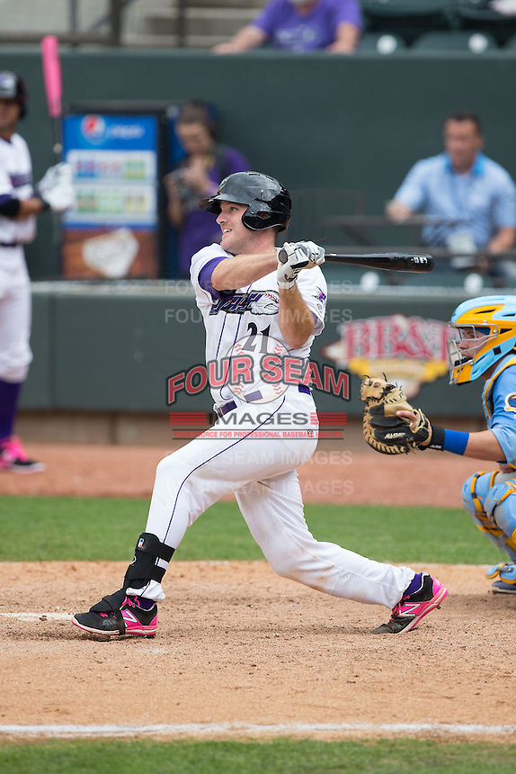Jeremy Dowdy (21) of the Winston-Salem Dash follows through on his swing against the Myrtle Beach Pelicans at BB&T Ballpark on May 10, 2015 in Winston-Salem, North Carolina.  The Pelicans defeated the Dash 4-3.  (Brian Westerholt/Four Seam Images)