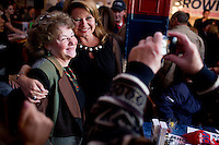 "Gail Huff (right), wife of Senator Scott Brown (R-MA), greets supporters at a ""Women For Brown"" meet and greet at The Olde Post Office Pub in North Grafton, Massachusetts, USA, on Thurs., Nov. 2, 2012. Senator Scott Brown is seeking re-election to the Senate.  His opponent is Elizabeth Warren, a democrat."