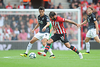 Southampton's Charlie Austin under pressure from Burnley's Jack Cork<br /> <br /> Photographer Kevin Barnes/CameraSport<br /> <br /> The Premier League - Southampton v Burnley - Sunday August 12th 2018 - St Mary's Stadium - Southampton<br /> <br /> World Copyright &copy; 2018 CameraSport. All rights reserved. 43 Linden Ave. Countesthorpe. Leicester. England. LE8 5PG - Tel: +44 (0) 116 277 4147 - admin@camerasport.com - www.camerasport.com
