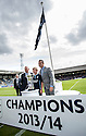 The 2013 / 2014 Championship trophy and flagged is presented to the growds at Dens Park, by Blair Kinmont (right) and club legends Gavin Rae and Pat Liney (left).