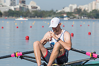 Rio de Janeiro. BRAZIL.   2016 GBR M1X. Alan CAMPBELL, wipes his sun glasses, before  the start of his heat at the Olympic Rowing Regatta. Lagoa Stadium,<br /> Copacabana,  &ldquo;Olympic Summer Games&rdquo;<br /> Rodrigo de Freitas Lagoon, Lagoa. Saturday  06/08/2016 <br /> <br /> [Mandatory Credit; Peter SPURRIER/Intersport Images]