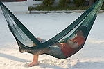 man Resting in hammock,Lying Down , Luxury  ,Resting , Day Dreaming , One Person, Serene People Horizontal,Hanging out