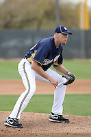Kameron Loe #50 of the Milwaukee Brewers participates in pitchers fielding practice during spring training workouts at the Brewers complex on February 18, 2011  in Phoenix, Arizona. .Photo by Bill Mitchell / Four Seam Images.