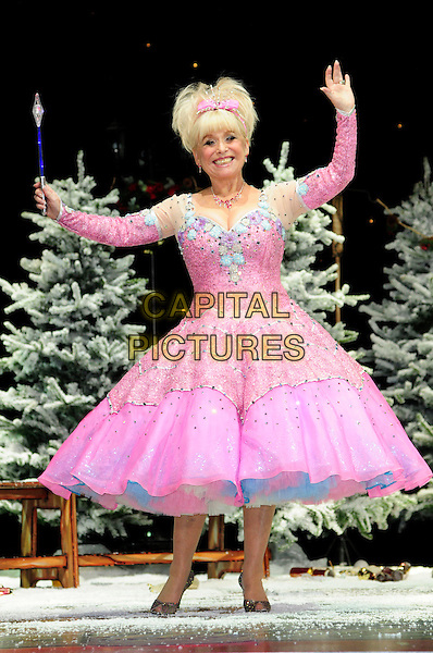 BARBARA WINDSOR .First Family Entertainment theatre company's annual group Pantomime photocall at Piccadilly Theatre, London, England..November 26th, 2010.stage costume panto pantomime full length pink dress wand fairy godmother arms .CAP/CAS.©Bob Cass/Capital Pictures.