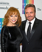 Reba McEntire and Narvel Blackstock arrive for the formal Artist's Dinner honoring the recipients of the 2014 Kennedy Center Honors hosted by United States Secretary of State John F. Kerry at the U.S. Department of State in Washington, D.C. on Saturday, December 6, 2014. The 2014 honorees are: singer Al Green, actor and filmmaker Tom Hanks, ballerina Patricia McBride, singer-songwriter Sting, and comedienne Lily Tomlin.<br /> Credit: Ron Sachs / Pool via CNP