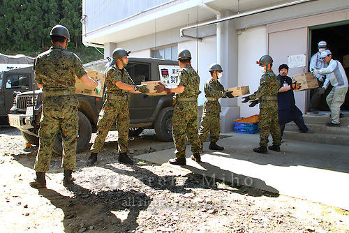 May 18, 2011; Minamisanriku, Miyagi Pref., Japan - 2:31 p.m. Soldiers from Japan's Self-Defense Forces offload a shipment of kitsuden udon at the Shizukawa High School Evacuation Center in Minamisanriku after the March 11, 2011 Great Tohoku Earthquake and Tsunami devastated the Northeast coast of Japan.