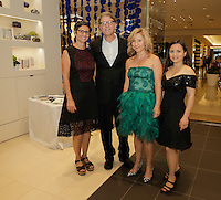 Sherry Hoffman, Todd Erlandson, Lara Hoad and Summer Vaughn attend the Tadashi Shoji South Coast Plaza Re-Opening Celebration on July 11, 2013. (Photo by Inae Bloom/Guest of a Guest)