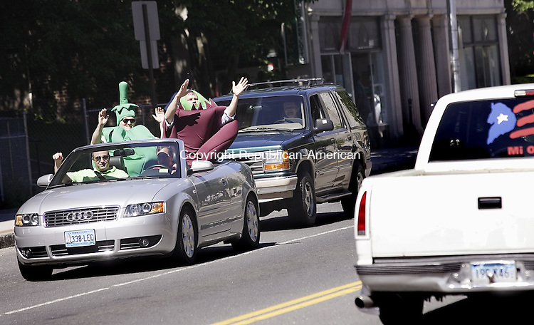 WATERBURY, CT-- 12 July 2007--07127TJ02- Dan Gaeta, second from left, dressed as a pepper, and Peter Abare-Brown, dressed as an eggplant, wave to passing cars during a 'parade' around The Green with Carl Rosa, at far left, CEO of Main Street Waterbury, and Steve Sasala, driving, Main Street Waterbury Board President, on Thursday, July 12, 2007, the opening day of Main Street's annual farmer's market. T.J. Kirkpatrick / Republican-American