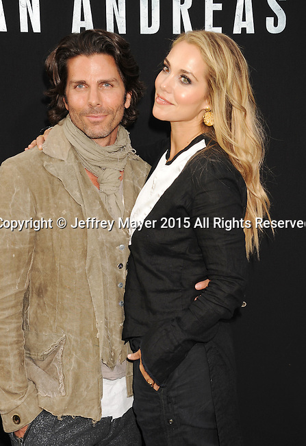 HOLLYWOOD, CA - MAY 26: Artist Greg Lauren and actress Elizabeth Berkley arrive at the 'San Andreas' - Los Angeles Premiere at TCL Chinese Theatre IMAX on May 26, 2015 in Hollywood, California.