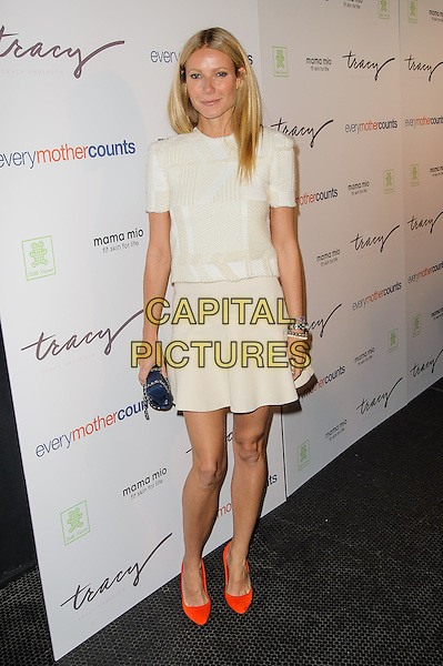 Gwyneth Paltrow.The Tracy Anderson Method Pregnancy Project Launch, New York, New York, USA 5th August 2012.full length top skirt dress sleeves red shoes white clutch bag blue chanel .CAP/ADM/BP.©Byron Purvis/AdMedia/Capital Pictures.